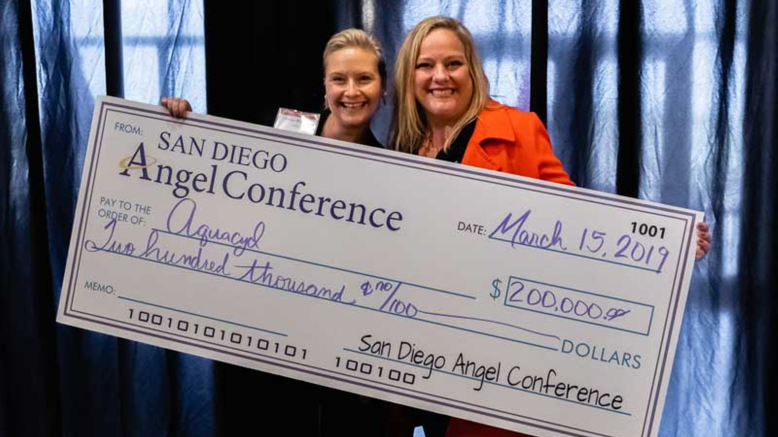 Recipient of check from the San Diego Angel Conference at The Brink SBDC